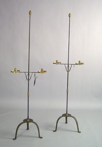 Pair of brass and wrought iron candlestands with a