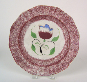 Red spatter paneled plate with tulip, 9 1/4