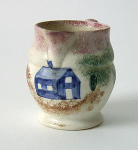 Red spatter creamer with blue schoolhouse, 3 1/2