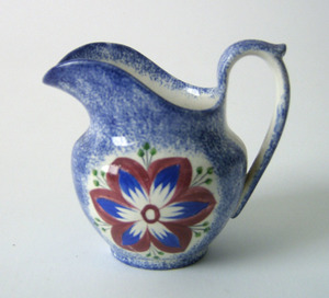 Blue spatter creamer, 19th c., with dahlia, 4 1/4