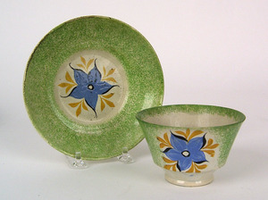 Green spatter cup and saucer, 19th c., with mornin