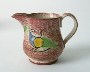 Red spatter creamer, 19th c., with peafowl, 3 1/2