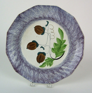 Purple spatter paneled plate with 3 brown acorns,0