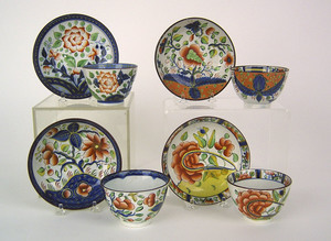 Four Gaudy Dutch cups and saucers, one with dove,n