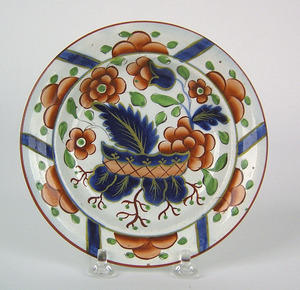 Gaudy Dutch plate, 19th c., in the warbonnet patte