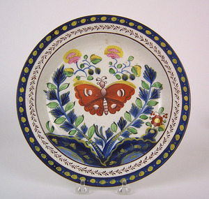 Gaudy Dutch plate, 19th c., in the center butterfl