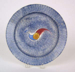 Blue spatter plate with blue, yellow, and red peaf