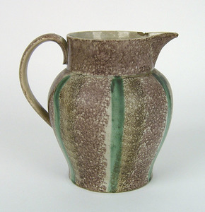 Brown, purple, and green rainbow spatter pitcher,