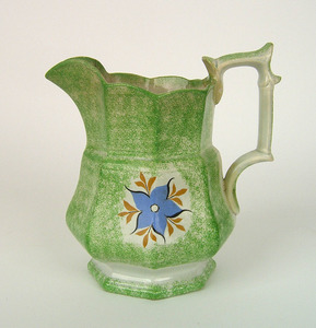 Green spatter paneled pitcher with blue morning gl