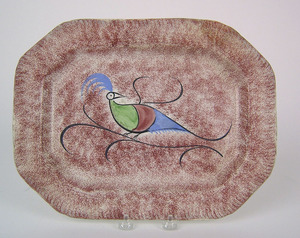Red spatter platter, 19th c. with peafowl, 10 1/4