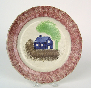 Red spatter plate with blue schoolhouse, 9 1/2