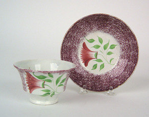 Red/purple spatter cup and saucer, 19th c., with t