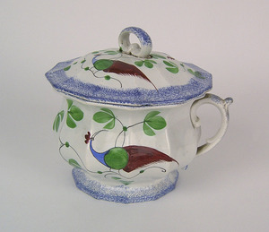 Blue spatter paneled chamber pot with blue, green,