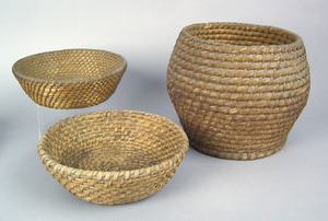 Two Pennsylvania round rye straw baskets, together