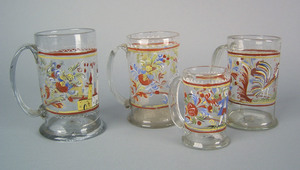 Four Stiegel type clear glass mugs, early 19th c.,