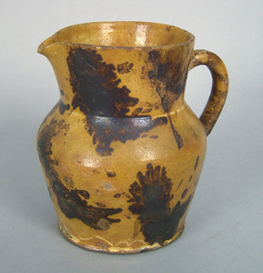 Pennsylvania redware pitcher with overall yellow g