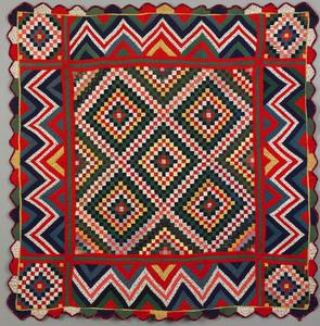 Vibrant Pennsylvania pieced crib quilt, late 19th.
