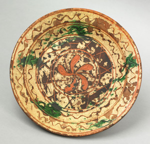 Pennsylvania redware shallow bowl, 18th c., with s