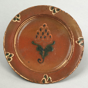 North Carolina redware plate, late 18th c., with g