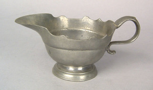 Pewter creamer, 18th c., with scalloped rim, impre