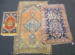 Three oriental mats, 5'8
