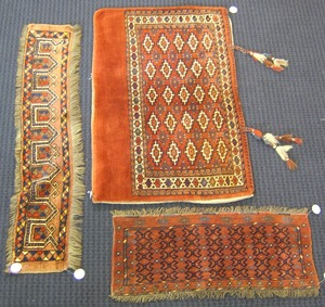 Two Turkoman mats, together with a saddlebag.