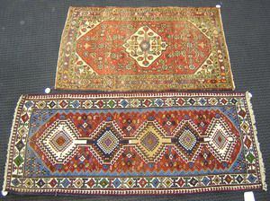 Two oriental throw rugs, 5' x 3'1