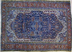 Roomsize Heriz rug, ca. 1910, with blue field, ivo