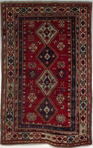 Caucasian throw rug, late 19th c., with 4 medallio