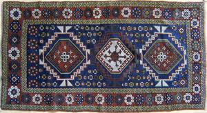 Kazak throw rug, ca. 1910, with 3 medallions on aa