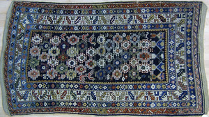 Kazak throw rug, ca. 1910, with repeating medallio
