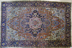 Roomsize Heriz rug, ca. 1930, with central navy me