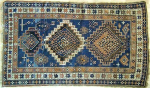 Two antique throw rugs, 7' x 4' and 7'8