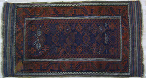 Turkoman throw rug, ca. 1900, with repeating medal