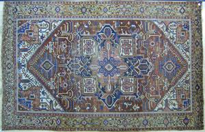 Roomsize Heriz rug, ca. 1920, with a blue medallio