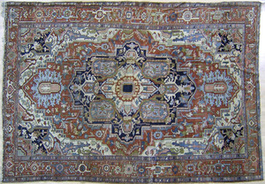 Roomsize Heriz rug, ca. 1920, with central navy me
