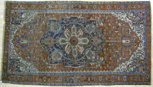 Roomsize Heriz rug, ca. 1910, with central medalli