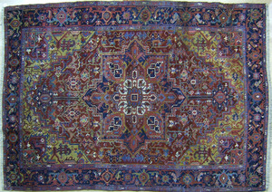 Roomsize Heriz rug, ca. 1930, with a central medal