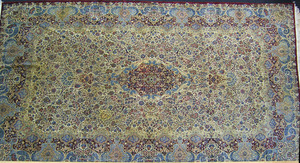 Roomsize Kirman rug, ca. 1930, with central red me