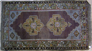 Two oriental throw rugs, ca. 1920, together with a