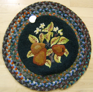 Three hooked mats, together with a hooked rug with