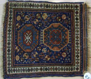 Three oriental mats.