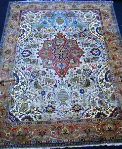 Semi antique roomsize Tabriz rug, 12'8