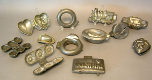 Twelve pewter ice cream molds, ca. 1900, to includ