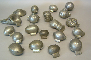 Twenty pewter ice cream molds, ca. 1900, most frui