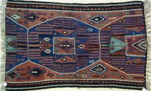 Kilim throw rug, ca. 1920, with geometric patternn