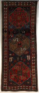 Cloudband Kazak long rug, ca. 1900, with 3 medalli