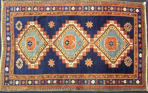 Kazak throw rug, ca. 1900, with 3 medallions on al