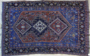 Afshar throw rug, ca. 1910, with 3 medallions anda