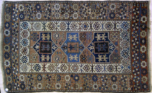 Kurdish Kazak throw rug, ca. 1915, with geometrice